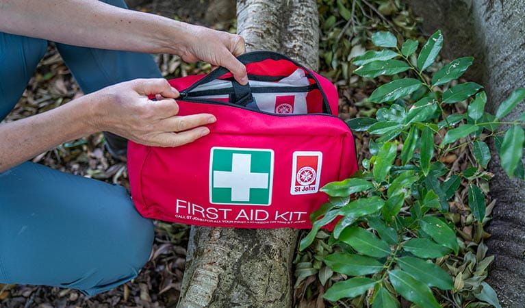 Person opening up a first aid kit. Photo: John Spencer/DPIE