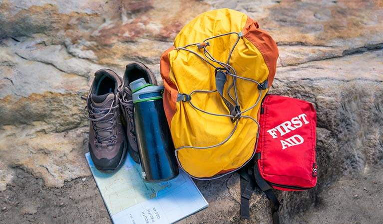 Backpack, first aid kit, water bottle, hiking shoes and map. Photo: John Spencer/DPIE
