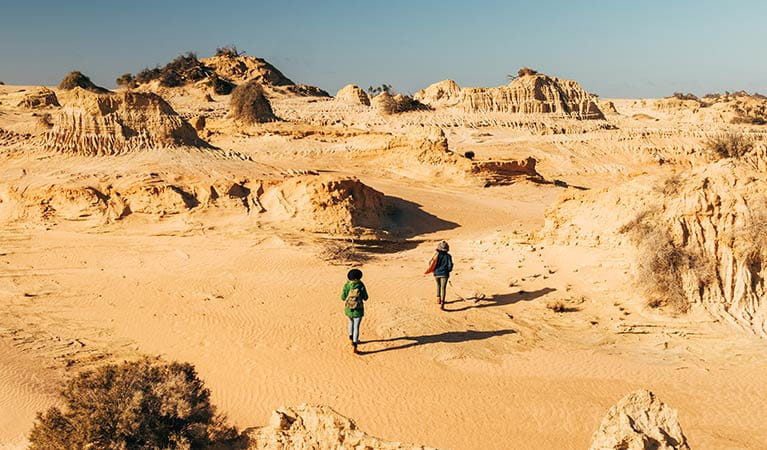 Friends walking in Mungo National Park. Photo: Melissa Findley/DPIE