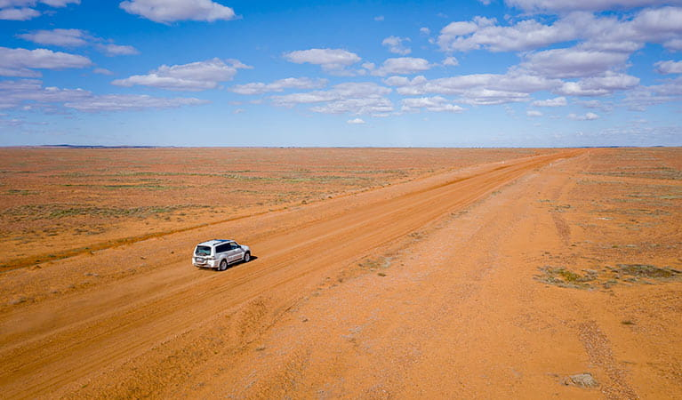 Aerial view of 4WD driving on the red earth in Sturt National Park. Photo: John Spencer/DPIE