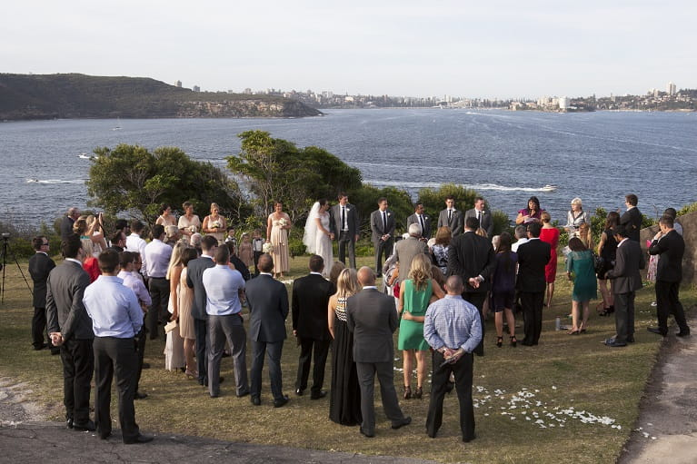 Bride and groom celebrate wedding at Middle Head, Sydney Harbour National Park.