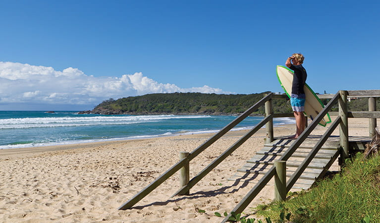 Surfer at Ocean View Beach, Coffs Coast Regional Park. Photo: Rob Cleary
