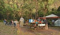 Volunteers enjoying a camp dinner, Marramarra National Park. Photo: Tegan Burton/NPWS