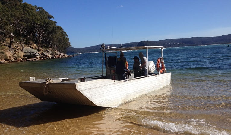 Volunteers arrive at Lobster Beach, Bouddi National Park. Photo: Deb Holloman/NPWS