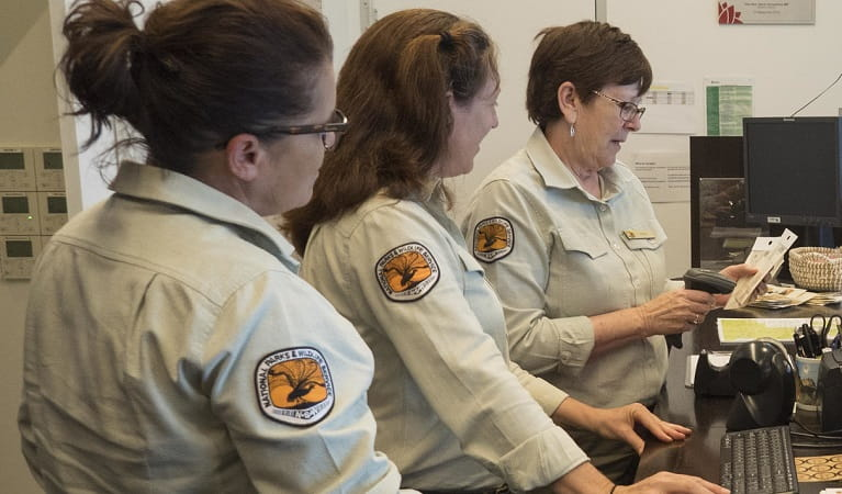 Three NPWS workers at the Warrumbungle Visitor Centre. Photo: Leah Pippos © DPIE