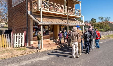 Visitors take a guided tour in Hill End Historic Site. Photo: John Spencer