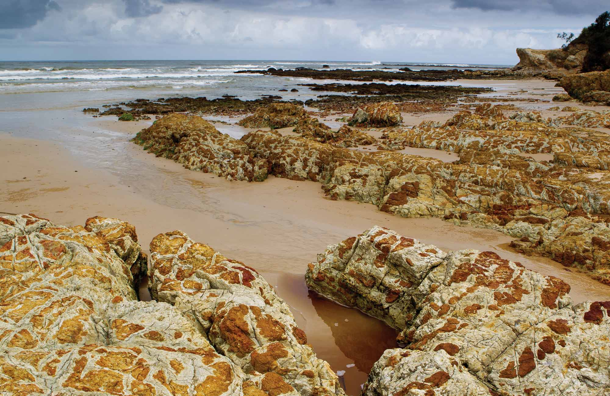 Golden sand and rocks in Yuraygir National Park. Photo: Rob Cleary