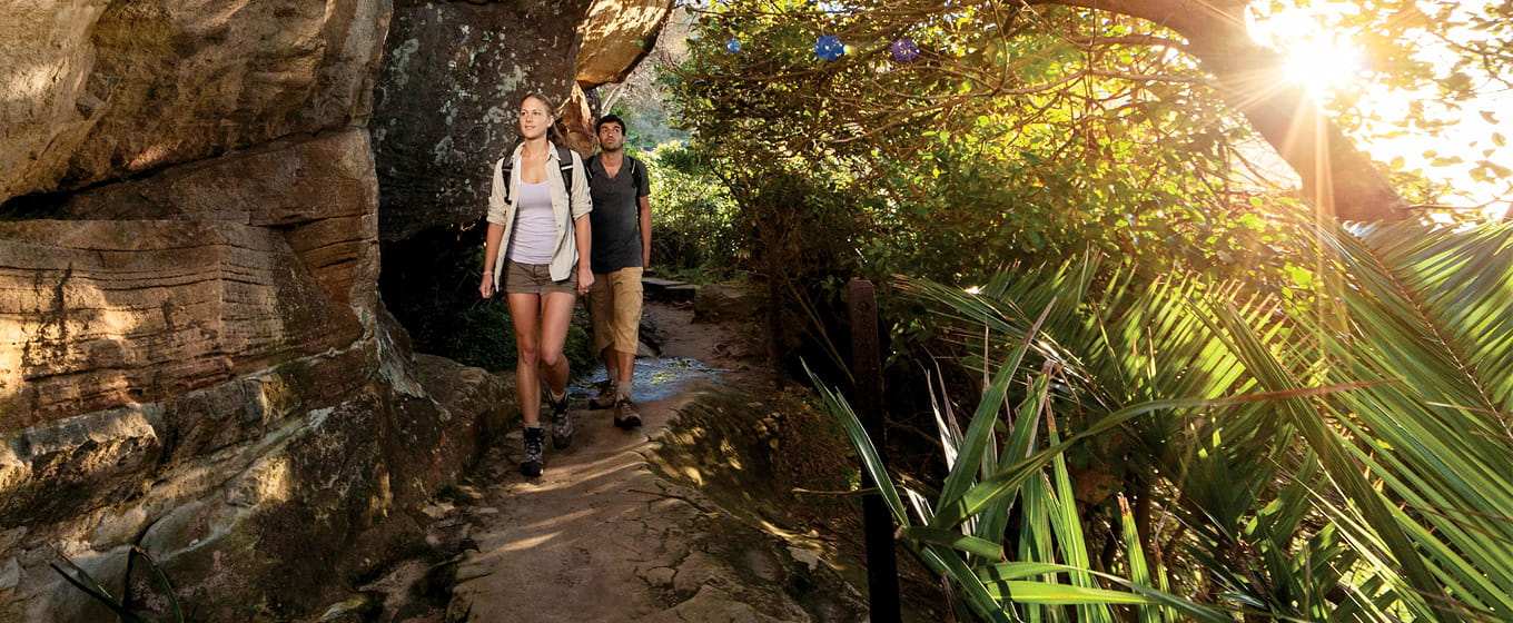 A couple walks along Smugglers track, Ku-ring-gai Chase National Park. Photo: D Finnegan/OEH