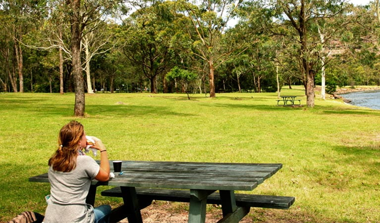 Woman sitting in the Davidson Park picnic area. Photo: Shaun Sursok