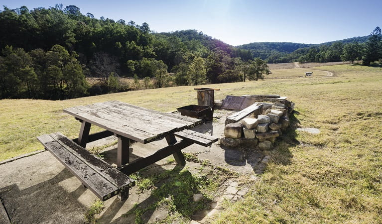 Fire pit and picnic table outside Big Yango House, Yengo National Park. Photo: Simone Cottrell/OEH