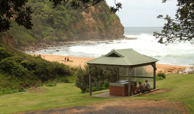 Picnic table, grass and ocean, Bouddi National Park. Photo: John Yurasek