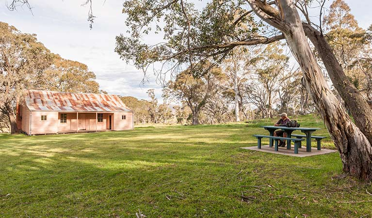 Picnic tables at Long Plain Hut, Kosciuszko National Park. Photo: Murray Vanderveer