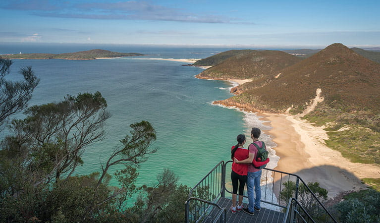 Couple at the lookout enjoying views of Zenith beach. Photo: OEH/J Spencer