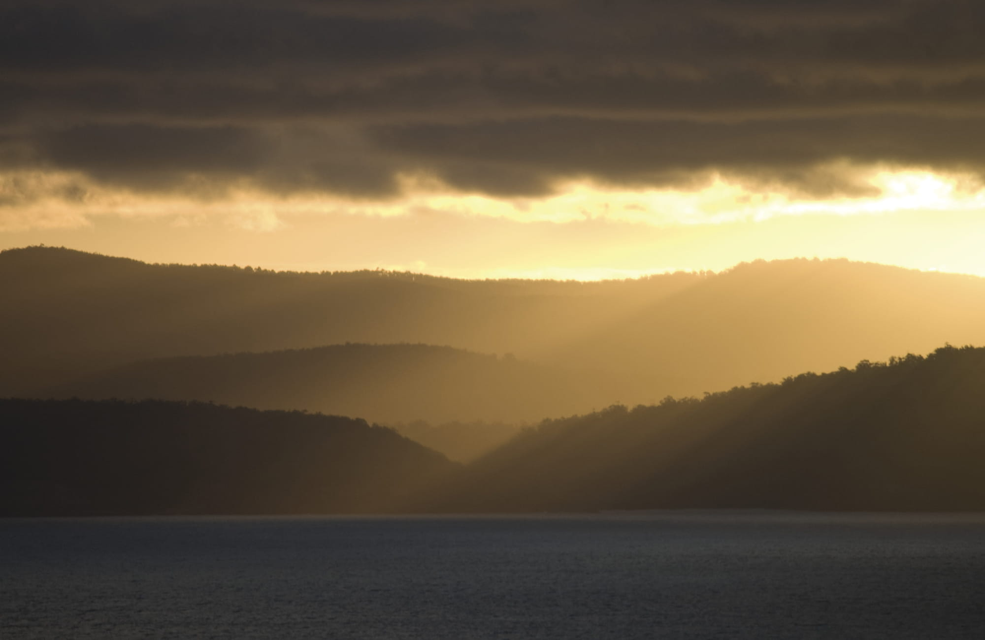 Sunset over sea and Ben Boyd National Park. Photo: A Brown/OEH