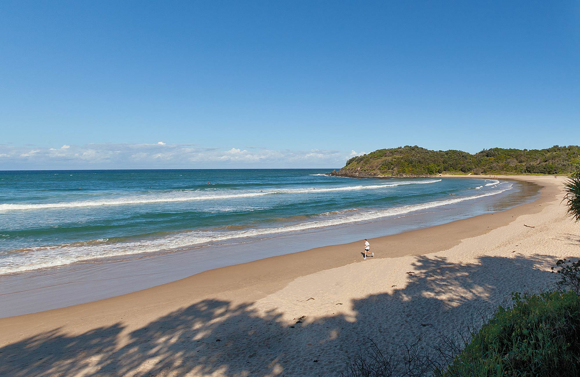 A Person Running Along Diggers Beach Photo Rob Cleary