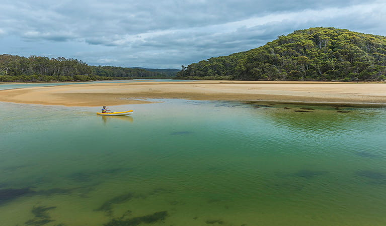 Kayaks on the sand, Nelson Lagoon, Mimosa Rocks National Park. Photo: John Yurasek